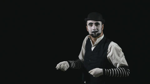 Young funny mime pulling an invisible rope Footage
