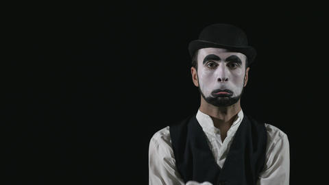 Young hilarious mime making funny facial expressions Footage