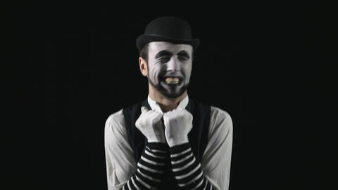 Young happy and funny mime being romantic and saluting an invisible public Footage