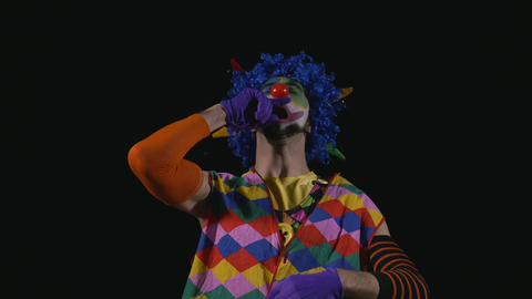 Young funny clown sneezing Footage