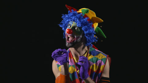 Young hilarious clown making funny faces Footage