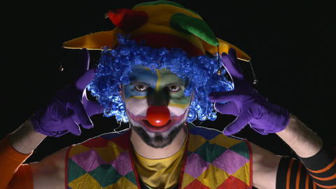 Young hilarious evil clown making scary faces Footage