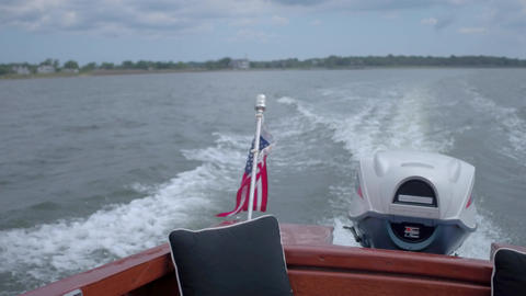 Looking back from a classic wooden boat Footage