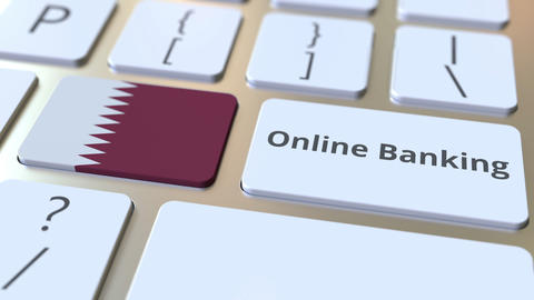 Online Banking text and flag of Qatar on the keyboard. Internet finance related ライブ動画
