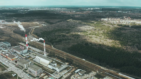 Aerial view of smoke stacks of a thermal power station near forest, Russia Live Action