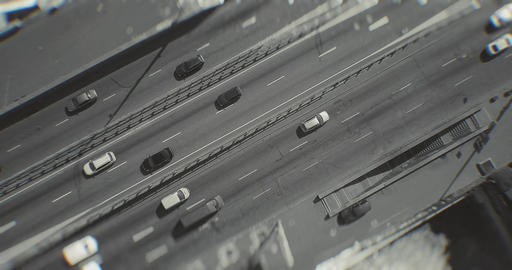 Top view of a drone flying on a freeway with cars on a sunny day. Black and white video with blur Live Action