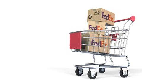Many cartons with FEDEX logo in shopping trolley. Editorial 3D animation Live Action