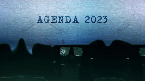Agenda 2023 words Typing on a sheet of paper with an old vintage typewriter Live Action