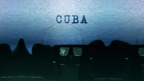 Cuba words Typing on a sheet of paper with an old vintage typewriter Live Action