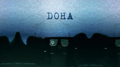 Doha words Typing on a sheet of paper with an old vintage typewriter Live Action