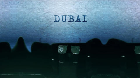 Dubai words Typing on a sheet of paper with an old vintage typewriter Live Action