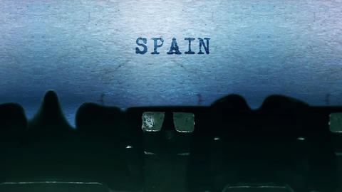 Spain words Typing on a sheet of paper with an old vintage typewriter Live Action