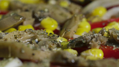 Homemade vegan pizza with mushrooms, pepper, corn and olives rotates on table Live Action