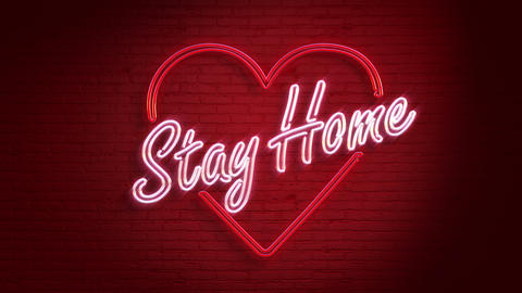 Stay Home Neon message on the wall in 4K GIF