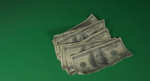 Dollars. American money close-up on a green background hromakey . 100 dollar Live Action