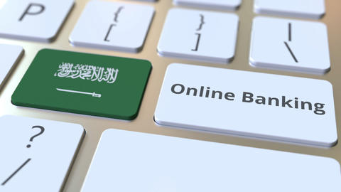 Online Banking text and flag of Saudi Arabia on the keyboard. Internet finance Live Action