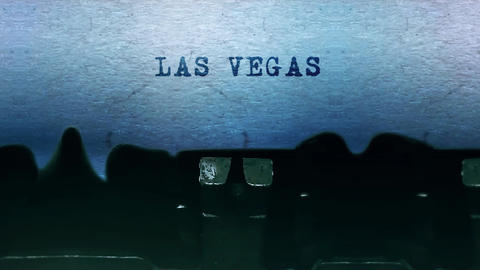 LAS VEGAS words Typing on a sheet of paper with an old vintage typewriter Live Action