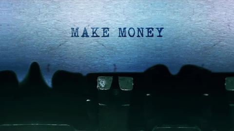 Make Money words Typing on a sheet of paper with an old vintage typewriter Live Action