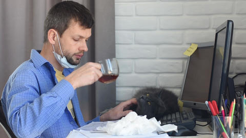 Sick quarantine employee takes off protective mask and drinks tea Live Action