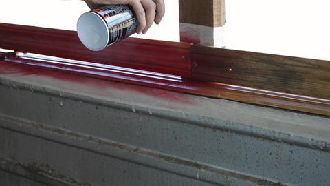 Paint a can of paint paint a wooden wall in red video Live Action