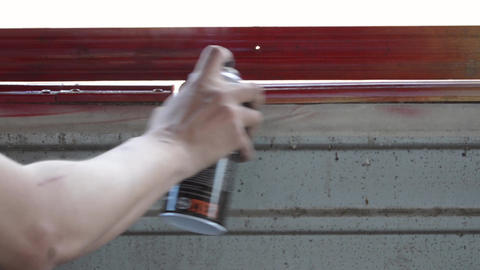 Paint in red painting a wooden wall in red video Live Action