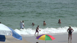Adults and children play on Ho Hum beach on Fire Island Stock Video Footage