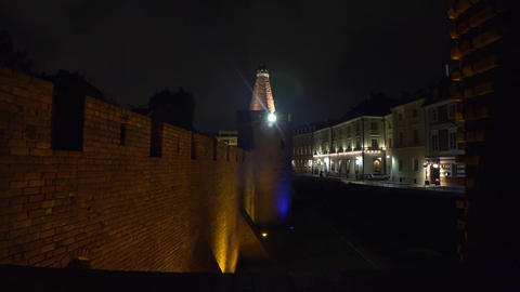 Brick wall in the old town of Warsaw. Night, lights. Poland. 4K Footage
