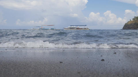 Water's edge of Amed beach, Bali Live Action