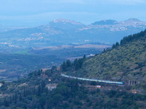 The train travels along the slope. Dawn. Tivoli, Italy Footage