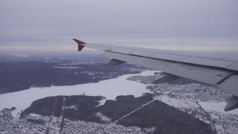 Flying on airplane over winter Moscow, Russia 4k Footage