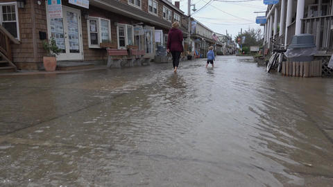 View of people in flooded area Footage