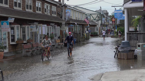 View of tourist escaping rising flood waters Live Action