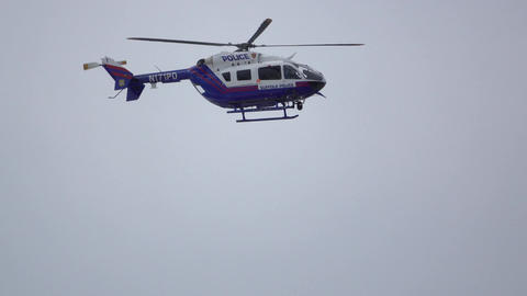 Rescue helicopter searches for missing people Footage