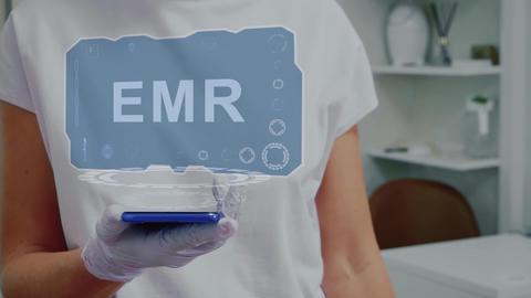 Doctor with hologram EMR Live Action