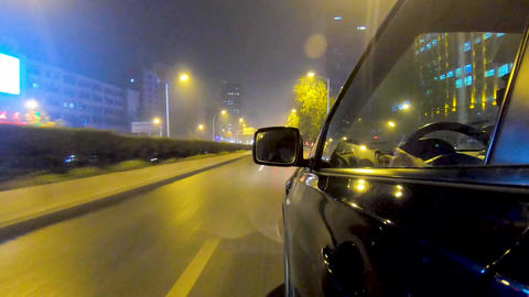 Night timelapse side view of the car and driver inside the car on the road of Live Action