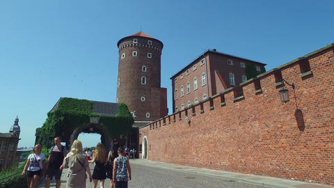 Tourist Walking by the Walls of Wawel Castle, Krakow Poland Live Action