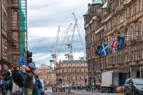 View of Edinburgh royal mile with the large harbor cranes in the background Photo