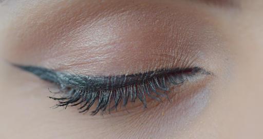Macro close-up brown woman's eye. Human eye, eyelash, eyelid, brown iris, face Live Action