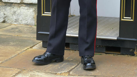 Boots close-up of a British Guard standing on duty Live Action