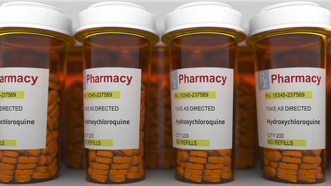 Row of pharmacy bottles with hydroxychloroquine generic drug pills as a possible Live Action