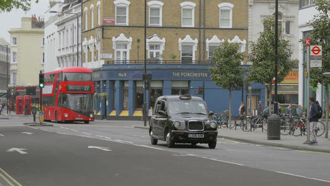 Double-decker red bus arrival in bus stop, London Live Action