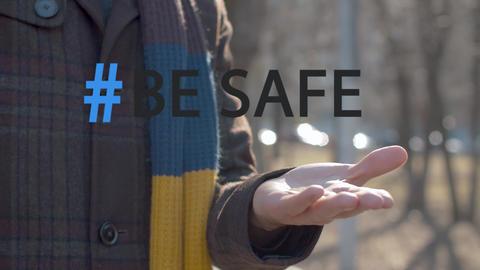 Hashtag be safe over hands applying sanitizer Live Action