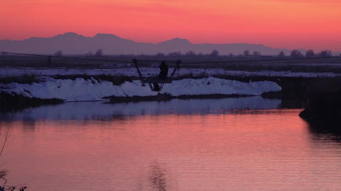 Person riding in cable trolley over bear river during sunset Live Action