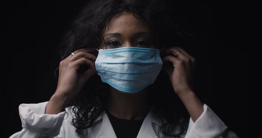 Girl puts on a medical mask Live Action
