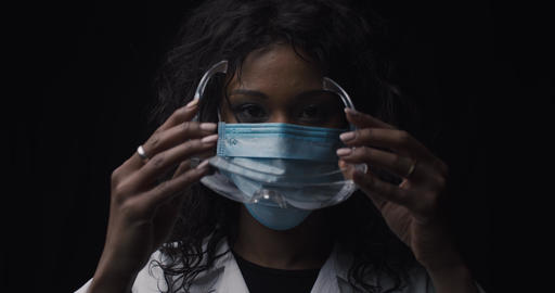 Lab technician puts on safety glasses Live Action