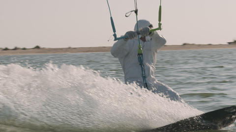 Man wearing medical personal protective equipmentKite Surfing In Ocean, Extreme Live Action