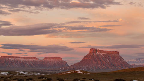 Time lapse of colorful sunrise over Factory Butte in the Utah desert Live Action