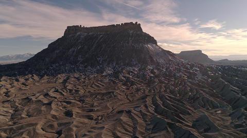 Flying through rugged desert terrain towards Factory Butte Live Action