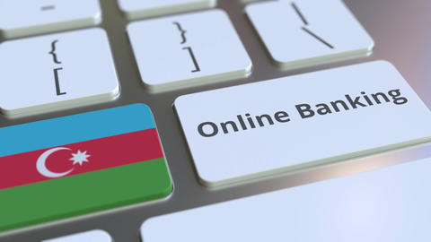 Online Banking text and flag of Azerbaijan on the keyboard. Internet finance Live Action