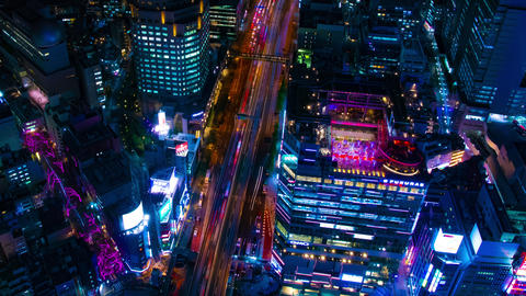 A night timelapse of the neon town in Shibuya Tokyo high angle wide shot panning Live Action